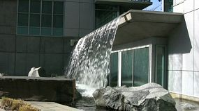 A lovely fountain coming over the front of a downtown apartment, Very stylish and funky! (HD 1080p30)