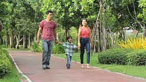A lovely Asian family enjoys a fun walk in the park in Bangkok, Thailand.