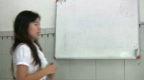 A Thai lady teaching an English Class to Thai students in Bangkok, Thailand.