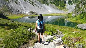 A cute 13 year old Asian teenage girl enjoys hiking near Mount Baker in the beautiful Pacific Northwest on a gorgeous summer day!