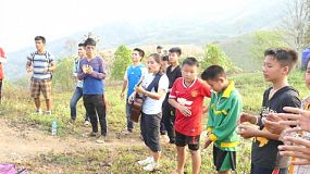 A group of Asian Christians singing praise and worship songs on top of a mountain in Chiang Rai, Thailand.