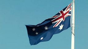 An Australian flag blowing in the wind.