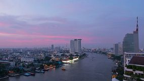 A time lapse of the Chaophraya River in Bangkok, Thailand at sunset.