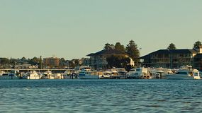 Late afternoon on the Swan River in Perth, Australia, with boats moored at a yacht club.