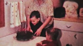 A cute little boy enjoys his 4th birthday including getting some cool presents in 1966.
