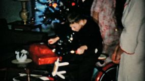 A cute little boy gets a brand new bike for Christmas in 1957.