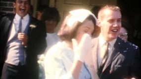 A happy bride and groom have confetti thrown at them as they leave the church following their wedding in the summer of 1958.
