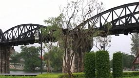 A right to left pan of the famous railroad bridge on the river Kwai near Kanchanaburi in Western Thailand.