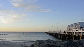 The famous Busselton Jetty as the sun goes down on a clear spring day, in Western Australia.