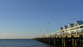 The famous Busselton jetty alit by the late afternoon sun on a clear spring day, in Western Australia.