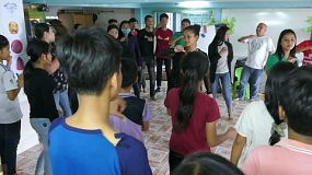 PHNOM PENH, CAMBODIA, DECEMBER, 2019: A Cambodian youth group practices a new dance complete with actions and singing in the slums of Phnom Penh.