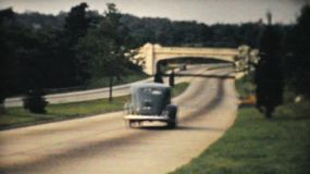 Cars speed down the new toll highway in New York State in the summer of 1940.