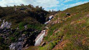Lesmurdie Falls in the hills of Perth, Western Australia, cascading down a hill.