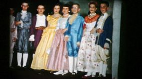 High school students do their curtain call after successfully performing Cinderella for their audience in 1956.