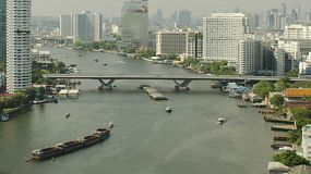 Timelapse of the Saphan Taksin bridge across the Chao Phraya river in Bangkok, Thailand.