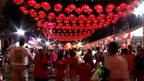 People stroll under the beautiful red lanterns during Chinese New Year – often called Chinese Lunar New Year which is the most important of the traditional Chinese holidays.