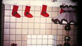 Pretty homemade Christmas stockings hang by the fireplace in 1961 waiting for Christmas morning.