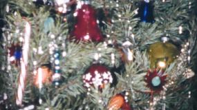 A close up shot of a beautiful Christmas tree decorated for the holidays in 1958.