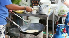A Thai street food vendor make delicious fried rice at the market in Bangkok, Thailand.