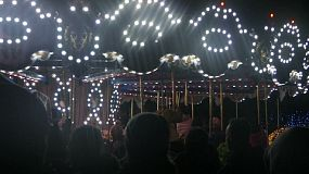 People enjoy crisp winter evening riding a festive old style Carousel during the Christmas holidays!