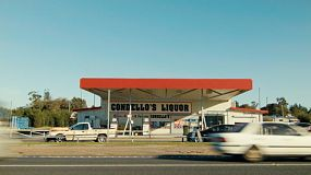 A country roadhouse and liquor store on a highway in rural Australia.