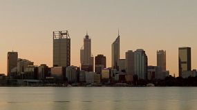 Downtown Perth City skyline across the Swan River at dusk.