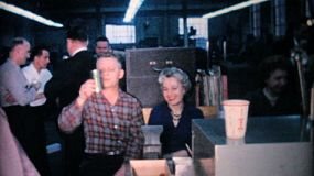 Coworkers and employees enjoy the company staff Christmas party with food, live music and games in December 1962.