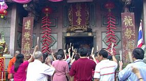 Scores of Asian people enter the temple to make offerings on Chinese New Year – often called Chinese Lunar New Year which is the most important of the traditional Chinese holidays.
