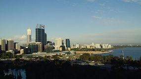 Time lapse of the City of Perth from King's Park in the evening, with the shadows fast encroaching on the city skyline,