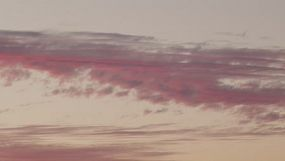 Time lapse of the fading colours and light on clouds in the sunset sky.