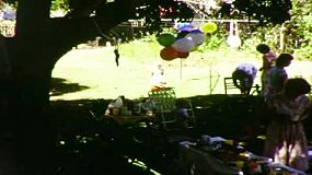 Party guests enjoying a child's backyard birthday party in Australia, in 1983.  Film has been transferred using a frame-by-frame scan to produce the highest quality.