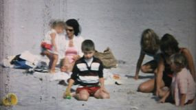 A family enjoys spending time relaxing and playing together at the beach in Florida in 1967.