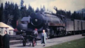 A family takes an old steam train to Lake Louise, Alberta through the Rocky Mountains in 1958.