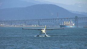 A close up shot of a float plane approaching the pier in a lovely harbor.