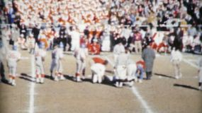 A college football player gets injured in a big New Year's Day bowl game in America in 1962.