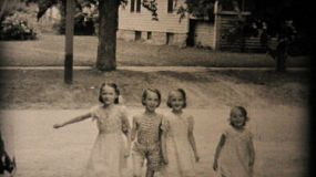 Four adorable little girls spend time together posing for pictures in the summer of 1950.