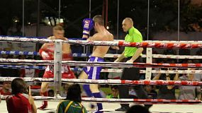Two Muay Thai kick boxers engage in some furious action in Bangkok, Thailand.