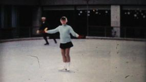 A young girl enjoy practicing figure skating at the Penn Center ice rink in downtown Philadelphia in December 1962.