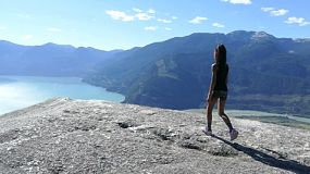 A cute little 10 year old Asian girl successfully climbs to the 2nd peak of the Chief in Squamish, BC on a gorgeous summer day.