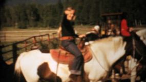 Sisters enjoy horse back riding together in the summer of 1964.