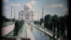 AGRA, INDIA, JUNE, 1957: Tourists enjoy exploring the beautiful Taj Mahal in Agra, India in the summer of 1957.