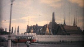 Classic footage of the famous Buddhist Wat Pra Gaew Grand Palace in downtown Bangkok, Thailand in 1958.