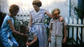 A pretty Grandmother poses with her daughter and grand kids in the backyard after a family gathering in 1966.