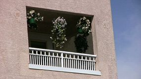 A lovely shot of a balcony with colorful flowers swaying in the gentle breeze on a gorgeous summer day! (HD 1080p30)