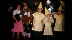 High school students do their curtain call after successfully performing Wizard of Oz for their audience in 1956.