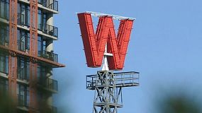 A large red W sign spins around and around in the heart of the city of Vancouver, BC, Canada.