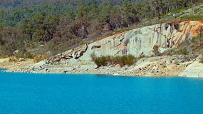 Looking across Lake C.Y. O'Connor from Mundaring Weir, near Perth, Western Australia, to a rocky outcrop on the opposing shore.