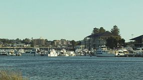 Looking across the Swan River near Fremantle, at yachts and boats moored at a yacht club.