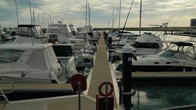 Looking down the walkway between rows of boats moored at Coogee Marina in Perth, Western Australia.