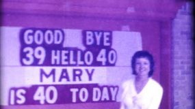 Mary comes outside to check out her new birthday sign as she gets ready to celebrated her 40th birthday in 1974.